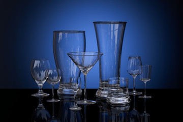 composition of glass goblets on a colored background