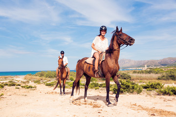 Young Tourist Couple Horseback Riding Wall mural