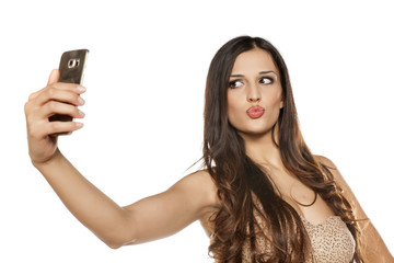 young beautiful women take selfies with her smartphone