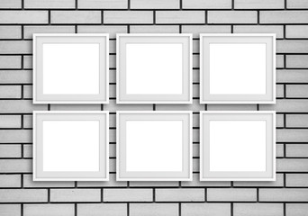 Group of six white photo frames on grey bricks wall, gallery style design mock up