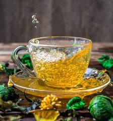 Green tea on wooden table