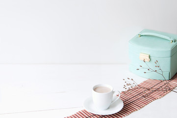 Minimal elegant composition with turquoise box and coffee cup