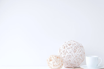 Minimal elegant composition with rattan balls and coffee cup