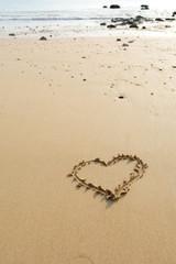Draw heart on beach. valentine day