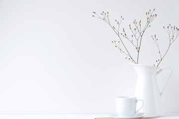 Minimal elegant composition with coffee cup and white vase