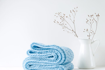 Minimal elegant composition with blue scarf and white vase