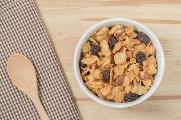 Corn flakes nutrition cereal and milk on wooden surface for healthy breakfast, Top view