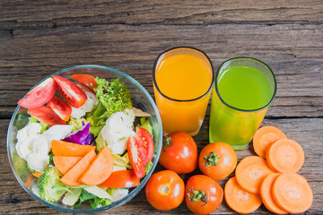 healthy foods are on the table, Fresh vegetable salad in a glass