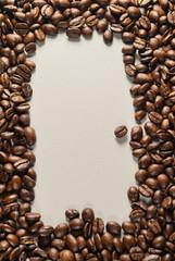 Coffebeans on Neutral Gray Background. Dark Roast Coffee.