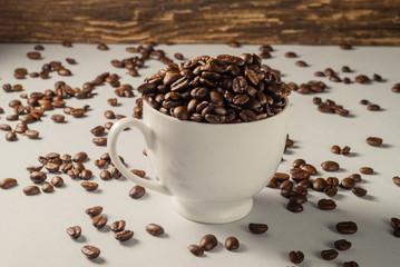 Coffebeans on Neutral Gray Background. Dark Roast Coffee. White