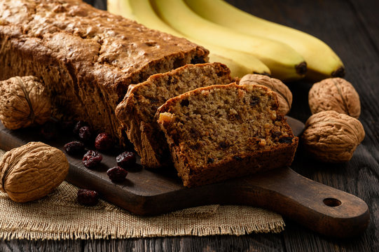 Homemade banana bread on wooden background.