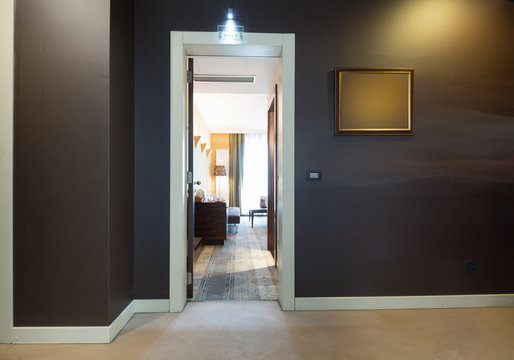 Hotel room entrance, view through the open door