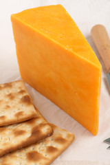 Red Leicester cheese and cream crackers a traditional British orange colored hard cheese