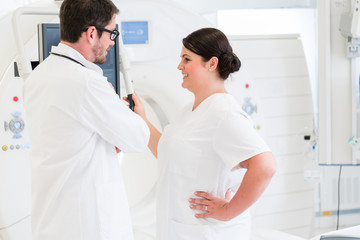 Doctor and nurse discussing image of MRI scan
