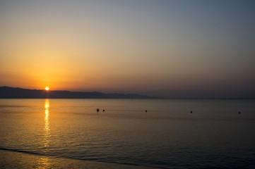 Alba fotografata al mare
