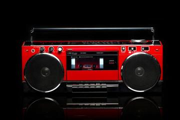 Retro red boom box on black background