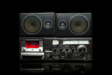 Vintage boom box on black background