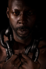 Portrait Of African Slave With Large Heavy Chain Around His Neck.