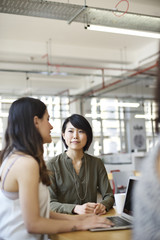 Asian businesswoman with colleagues in an office