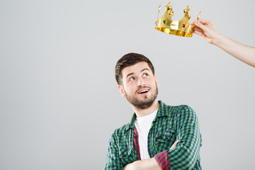 Young man with crown above his head