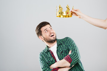Boy with crown above his head