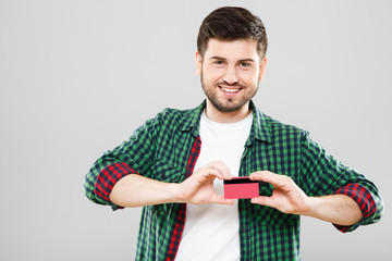 Boy holding red credit card