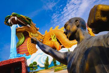 Bronze statue of Shaolin warriors monk at Dragon descendants Public museum