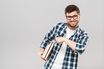 Man pointing at books