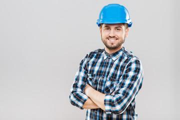 Man in blue building helmet