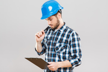 Builder with tablet thinking