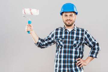 Man holding brush for painting walls