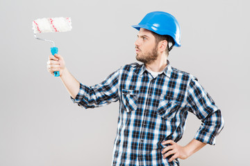 Man with brush for painting walls
