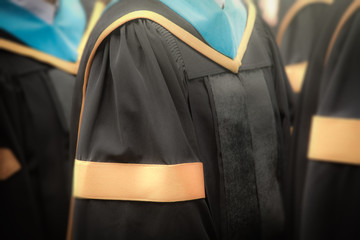 Selective focus on gowns of bachelor degree graduates in commenc