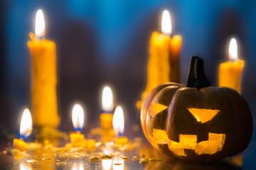 Halloween spooky Jack-O-Lantern pumpkin head with candles decora