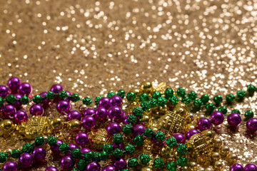 Mardi Gras Beads on Gold Glitter