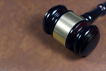 Law gavel on brown leather book (Justice concept)