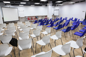 Light business room with lot of chairs is ready for conference