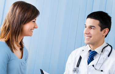 Young doctor and female patient