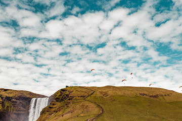 Waterfall and hang gliders