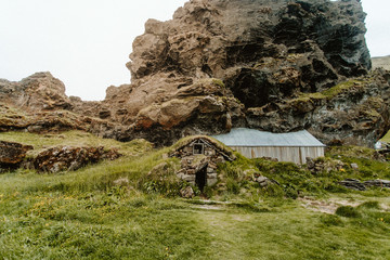 Hut under rock formation