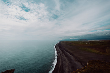 Scenic view of coastline and black sand beach