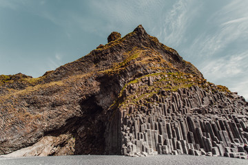 Mountain peak and rock formations by coast
