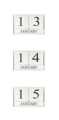 Closeup group of white wooden calendar with black 13 , 14 , 15 january word , three date calendar isolated on white background