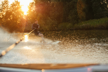 Man riding wakeboard on wave