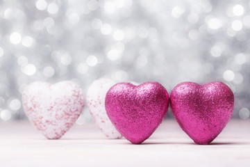 Valentines hearts over white abstract background