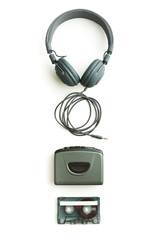 Vintage walkman, audio tape and headphones.