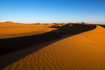 View of the dunes at sunset in Erg Chebbi near Merzouga in Morocco