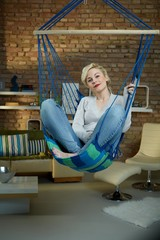 Happy woman in hanging chair