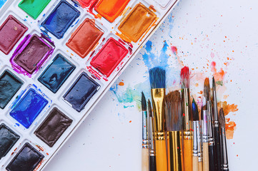 artistic brushes on wooden background