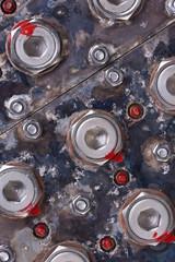 Old bolts on machine closeup